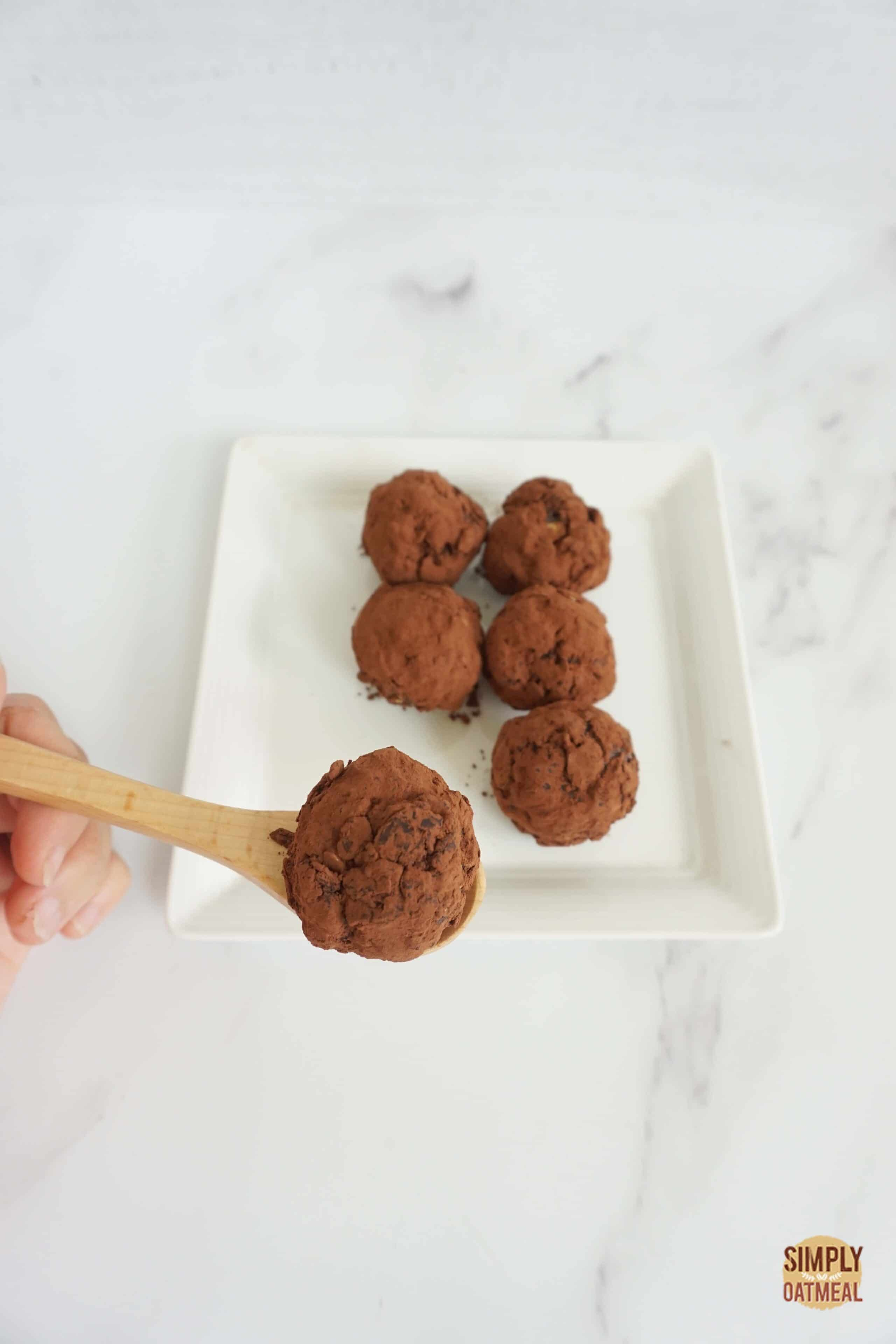 no bake chocolate oatmeal ball on a wooden spoon