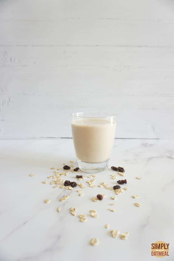 Single serving of oatmeal raisin cookie smoothie in a glass cup