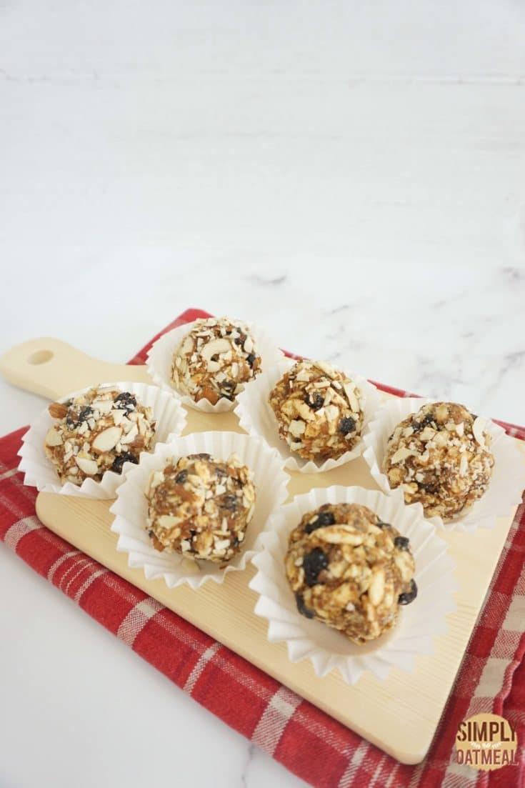 6 no bake blueberry muffin oatmeal balls in paper liners