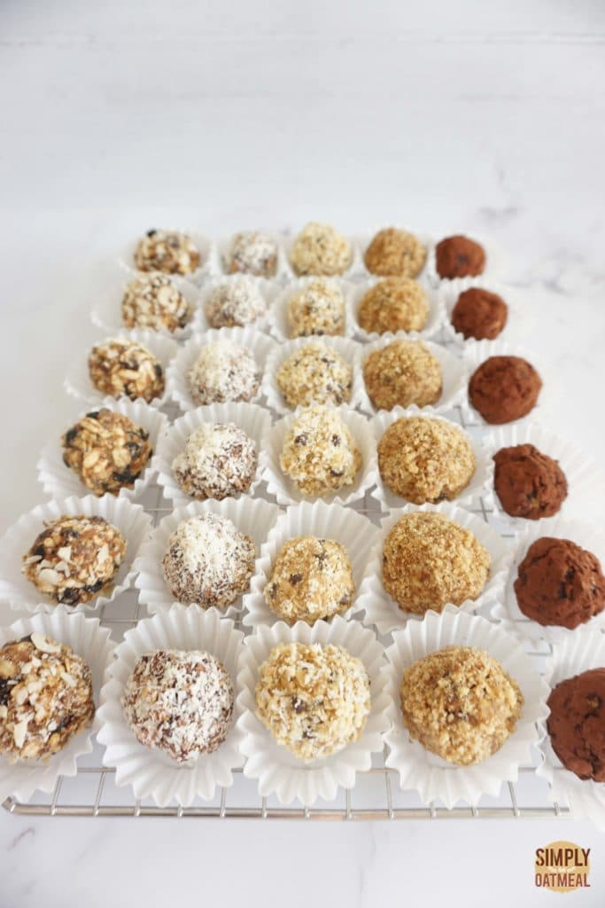 30 no bake oatmeal balls on a large tray. Each piece is in a paper liner cup.