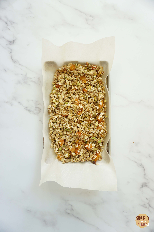 Apricot pistachio granola on a baking sheet pan