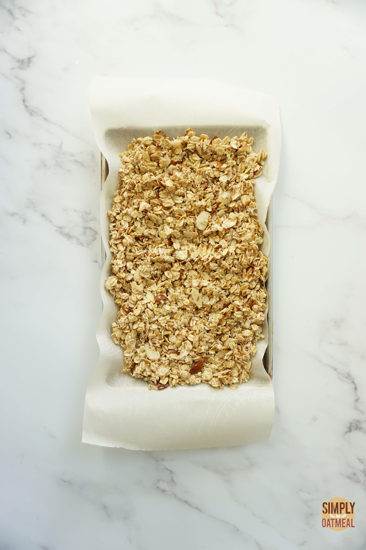 blueberry muffin granola on a baking sheet pan