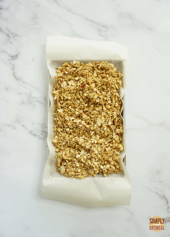 Cashew curry granola on a baking sheet pan