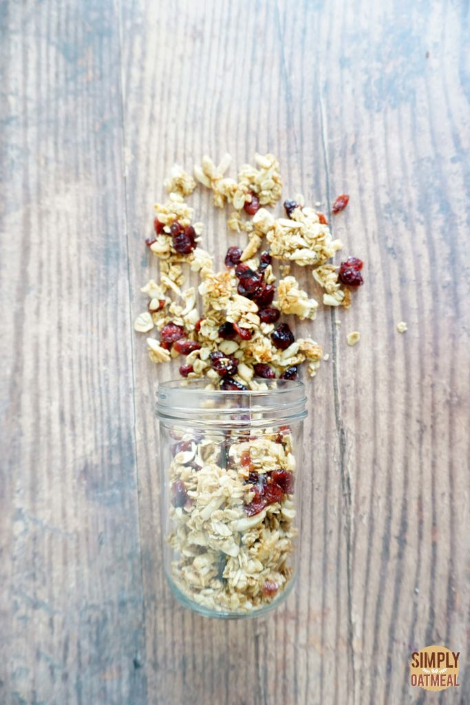 Cranberry almond granola combines almonds, cashews, shredded coconut and raisins with rolled oats