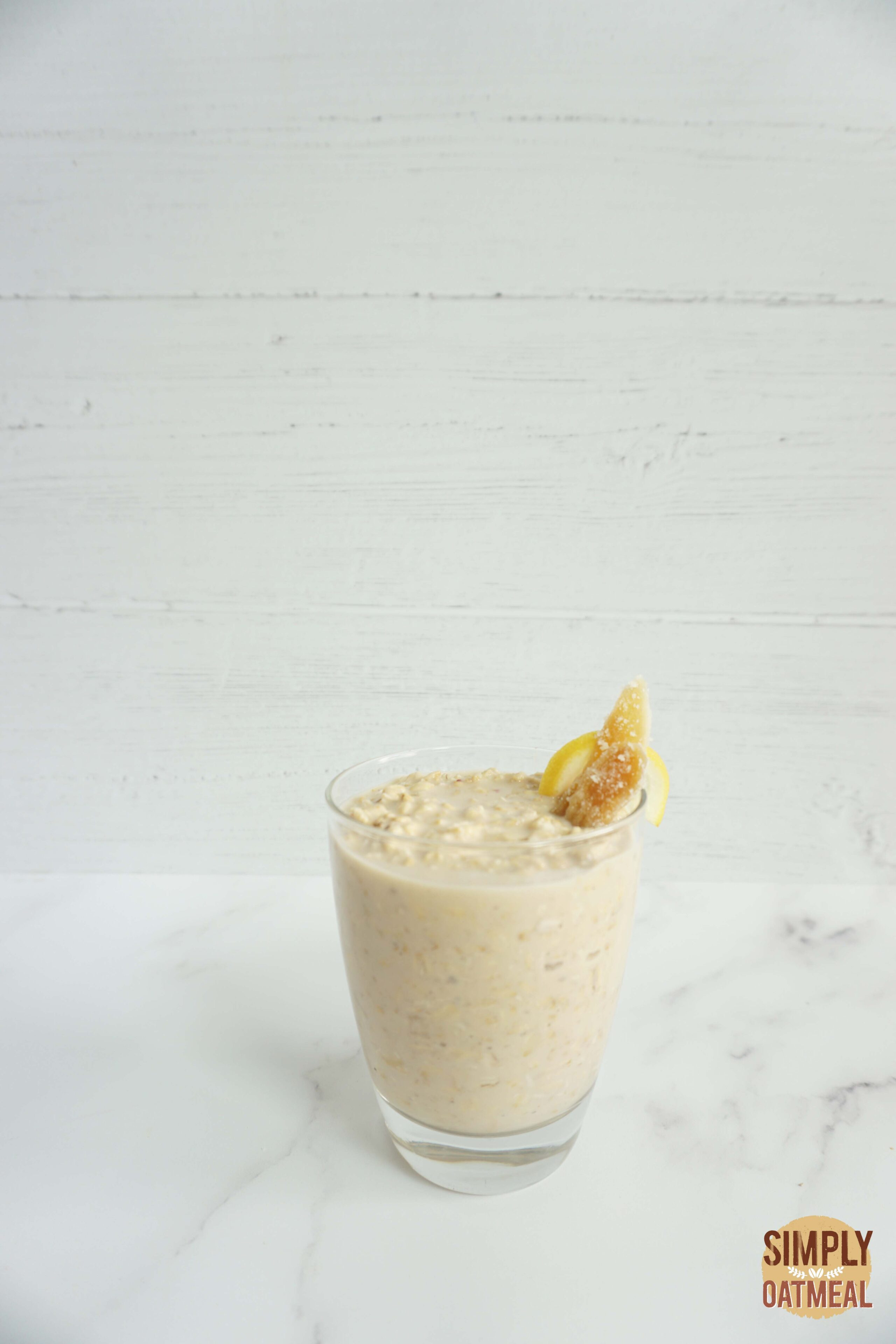 Single serving of gingerade lemonade overnight oats in a glass cup