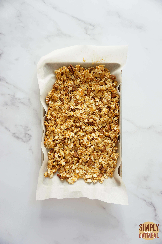 Sweet potato maple granola on a baking sheet pan