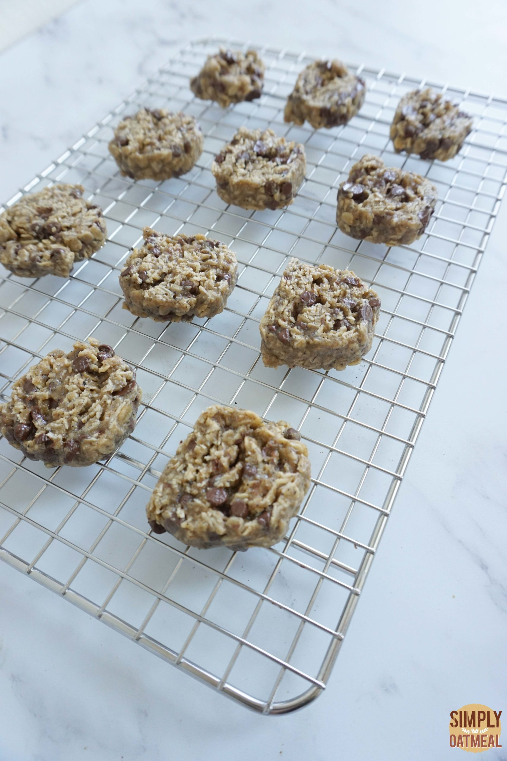 Hot espresso chocolate chip oatmeal cookies on a wire rack