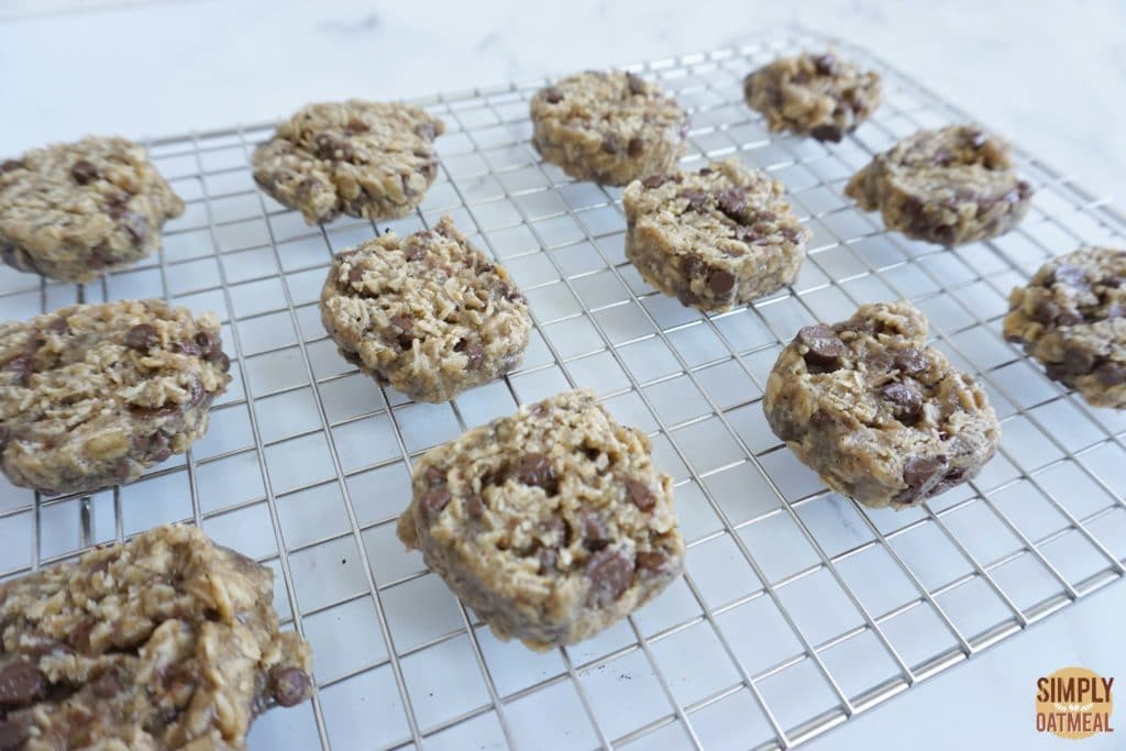 Fresh baked espresso chocolate chip oatmeal cookies cooling on a wire rack