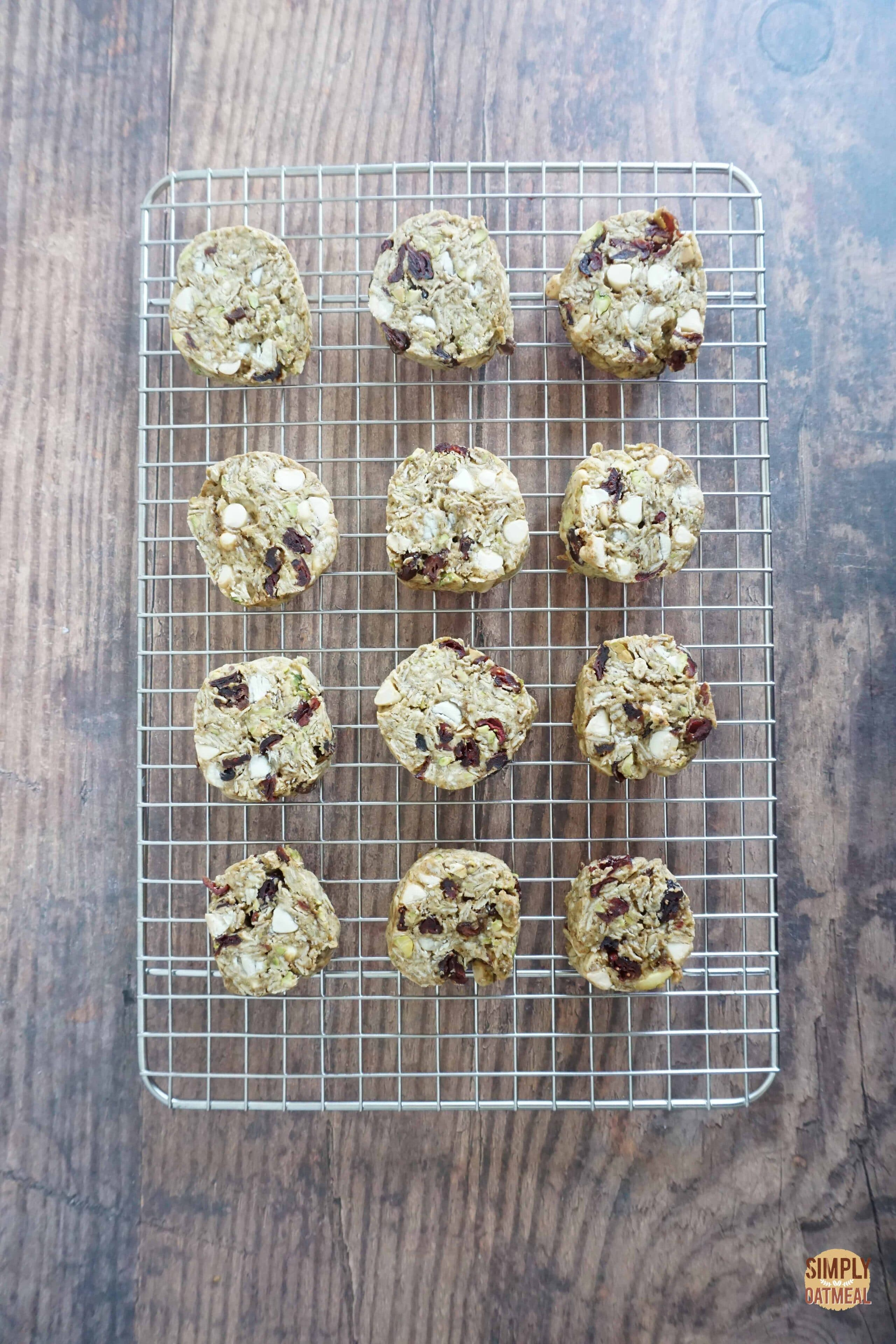 Fresh baked white chocolate cherry oatmeal cookies on a wire rack