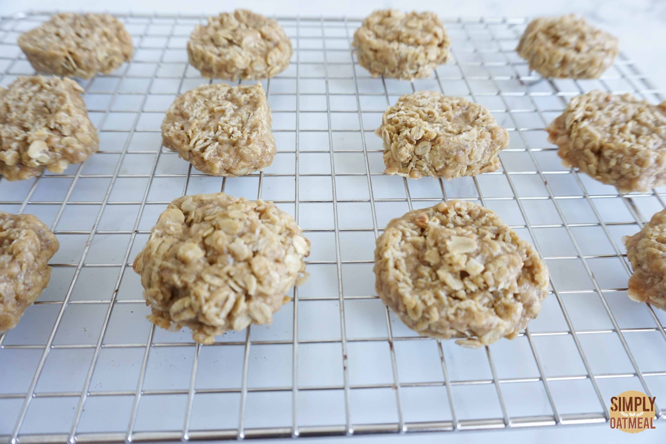 Hot toffee coconut oatmeal cookies cooling on a wire rack