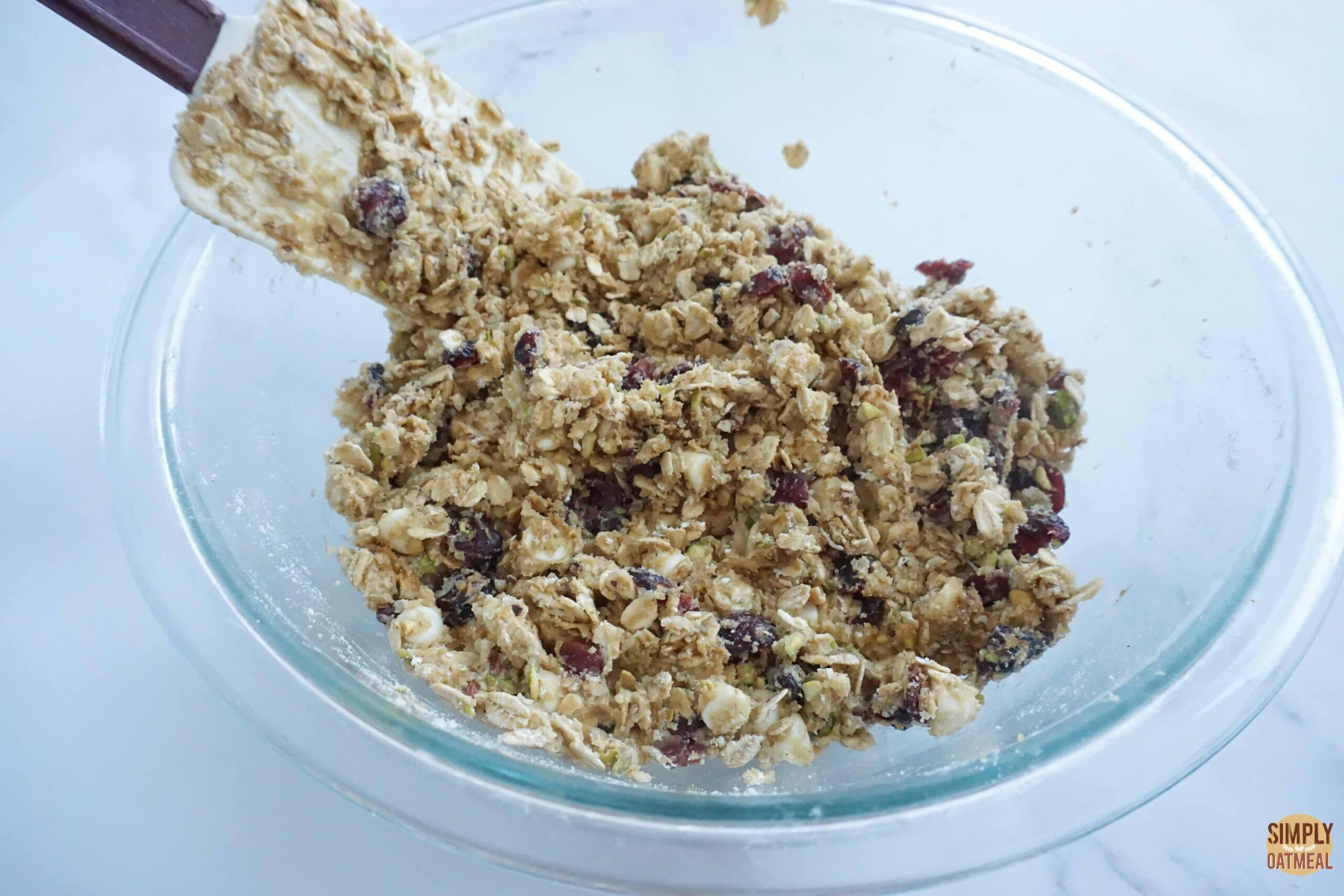 Mixing the wet and dry ingredients to make white chocolate cherry oatmeal cookies