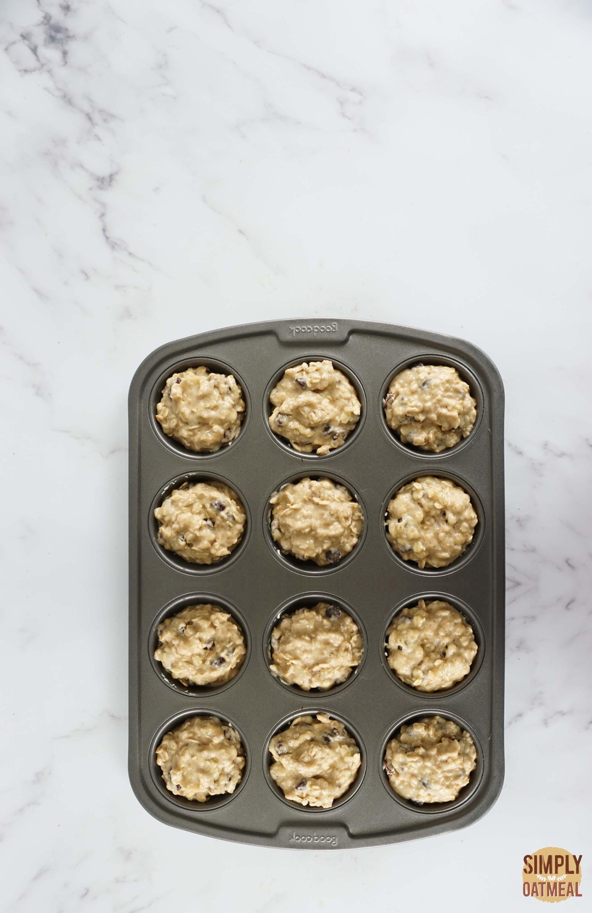Applesauce oatmeal muffins batter in a prepared muffin pan