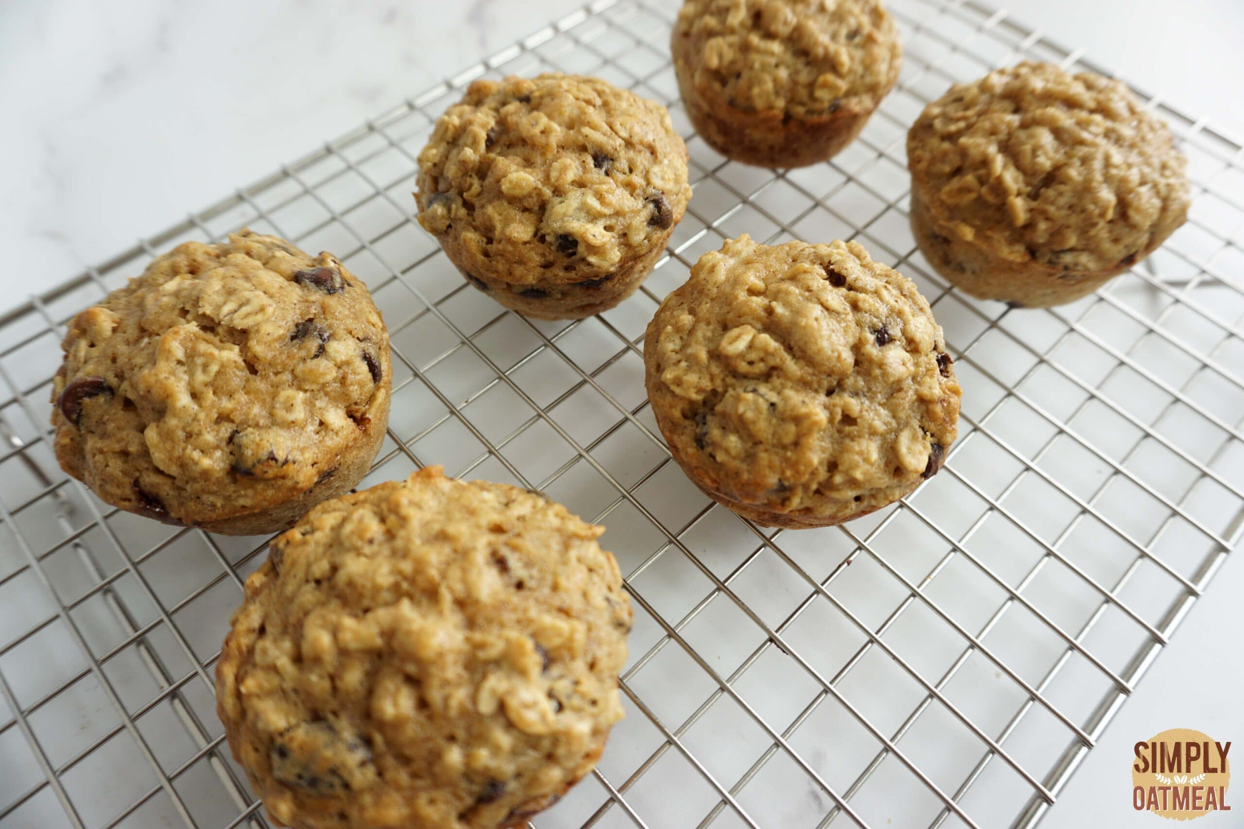 Applesauce oatmeal muffins cooling on a wire rack