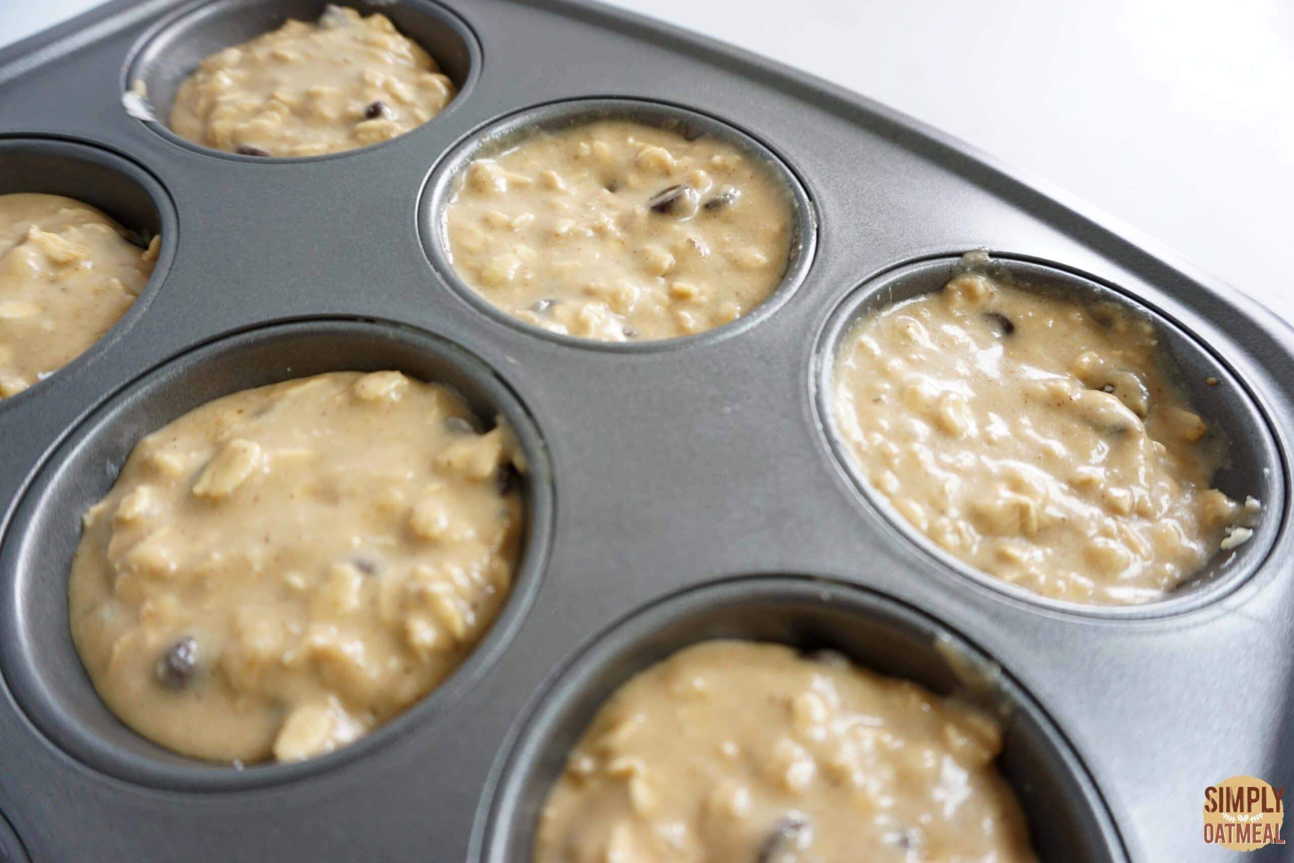 Baked chocolate chip oatmeal muffins in a muffin pan