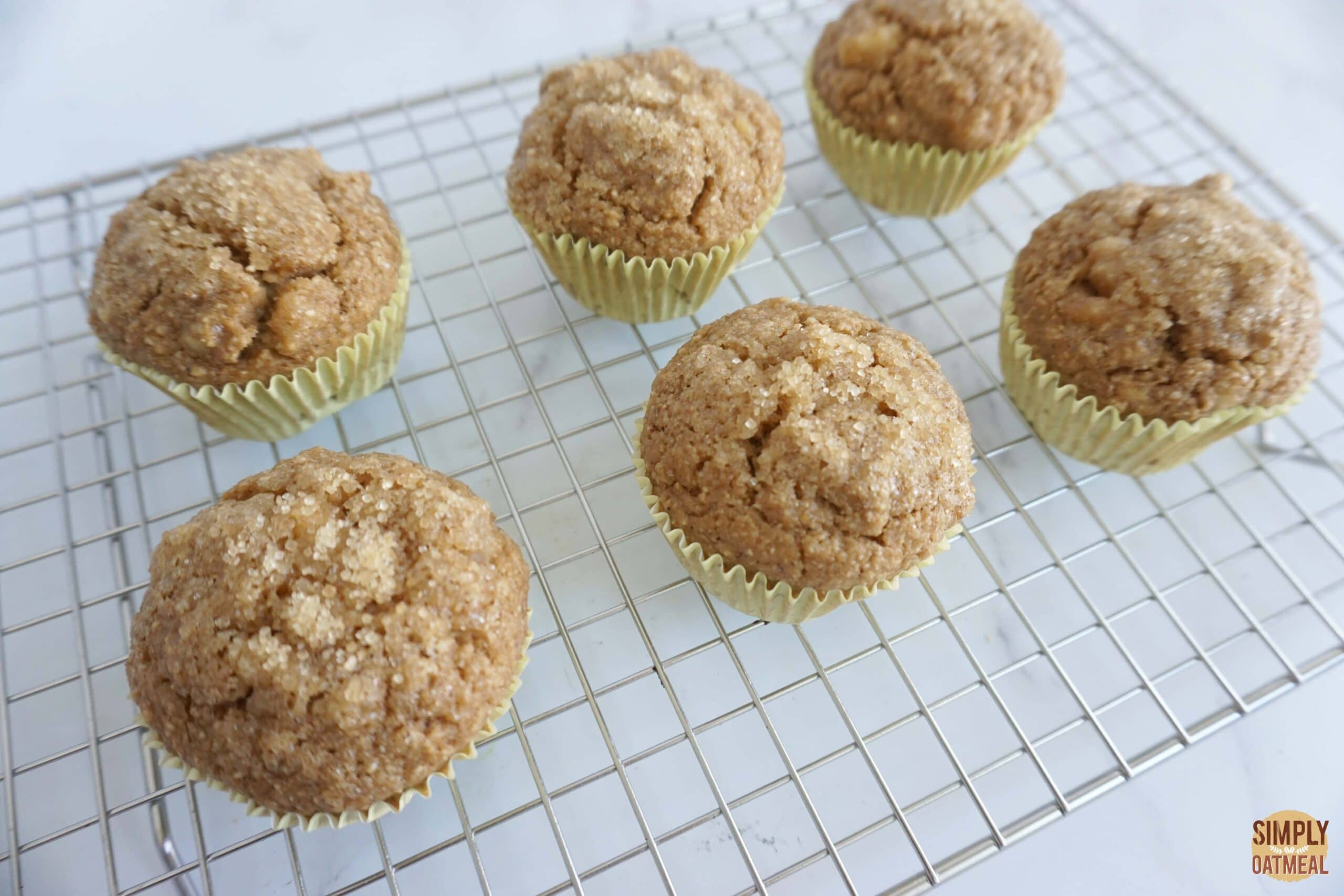 Vegan banana oatmeal muffins cooling on wire rack