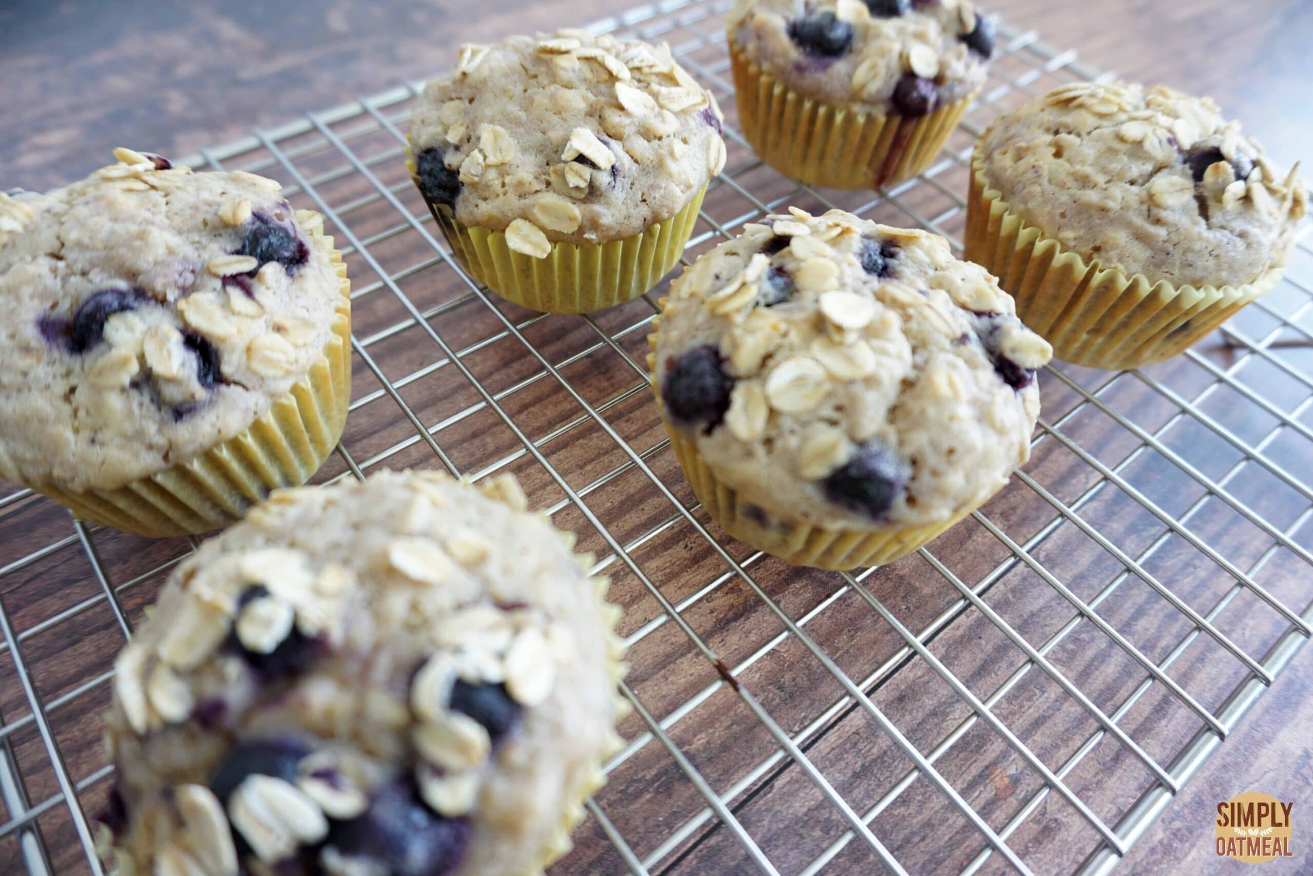Blueberry lemon oatmeal muffins cooling on a wire rack