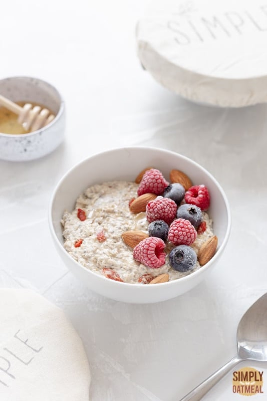 Bowl of overnight oats with almonds and berries on top