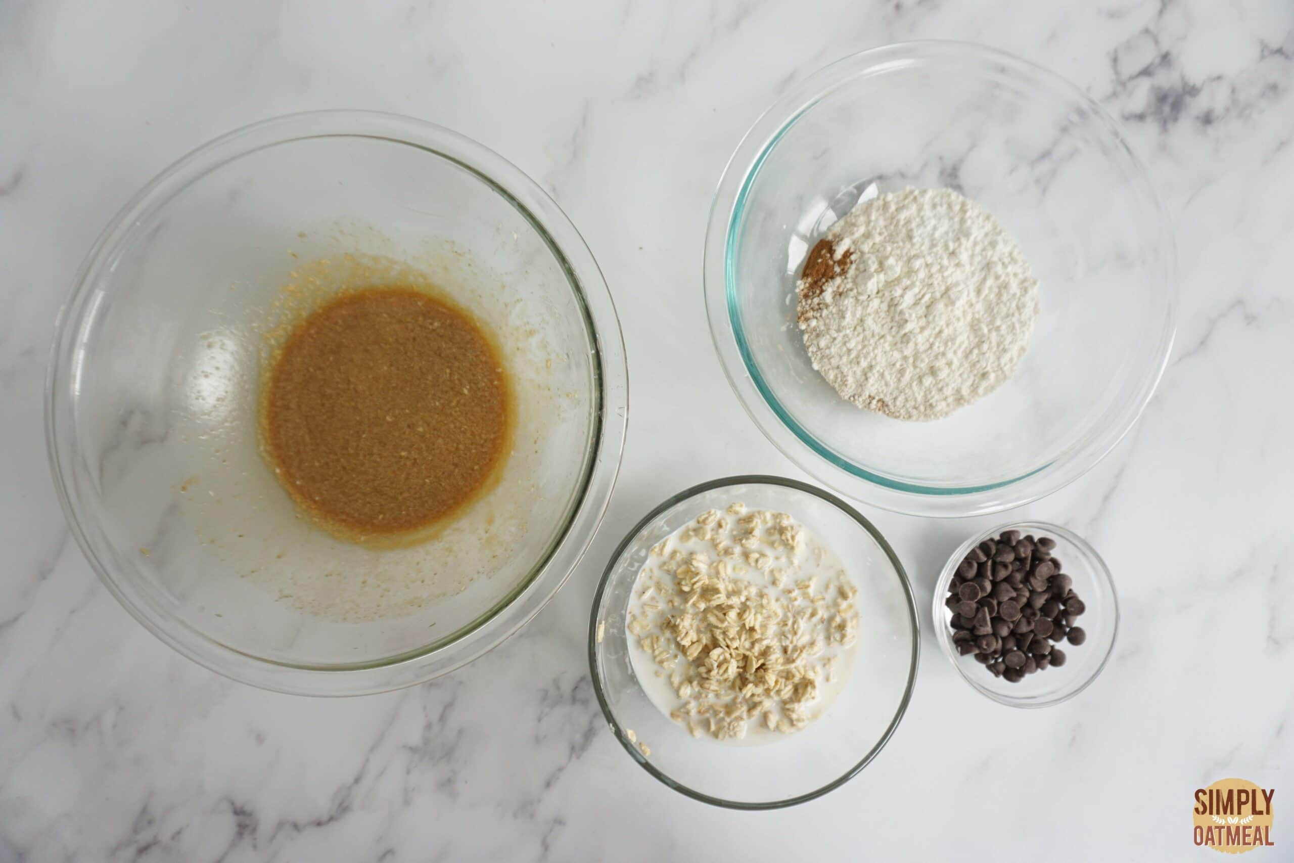 Wet and dry ingredients to make chocolate chip oatmeal muffins