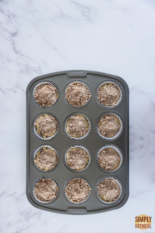 Cinnamon streusel oatmeal muffin batter in a muffin pan