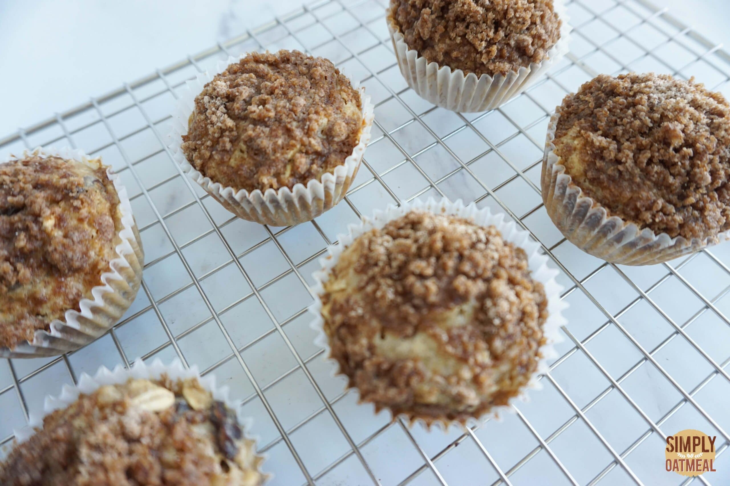 Cinnamon streusel oatmeal muffins cooling on wire rack