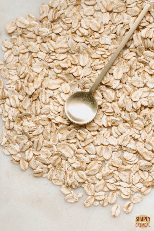 Do oats have gluten? Portion of rolled oats on a plate