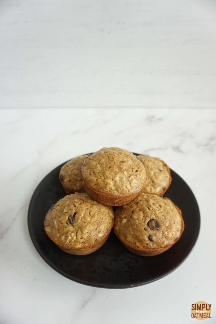 Fresh baked chocolate chip oatmeal muffins on a plate
