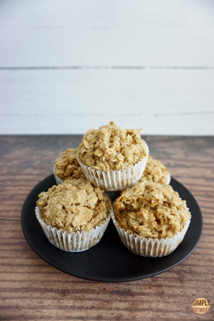 Fresh baked maple brown sugar oatmeal muffins on a plate