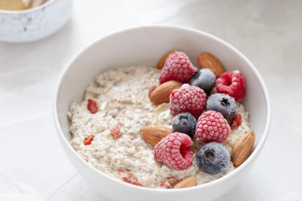 How do you reduce phytic acid in overnight oats. Bowl of soaked oats with almonds and berries on top