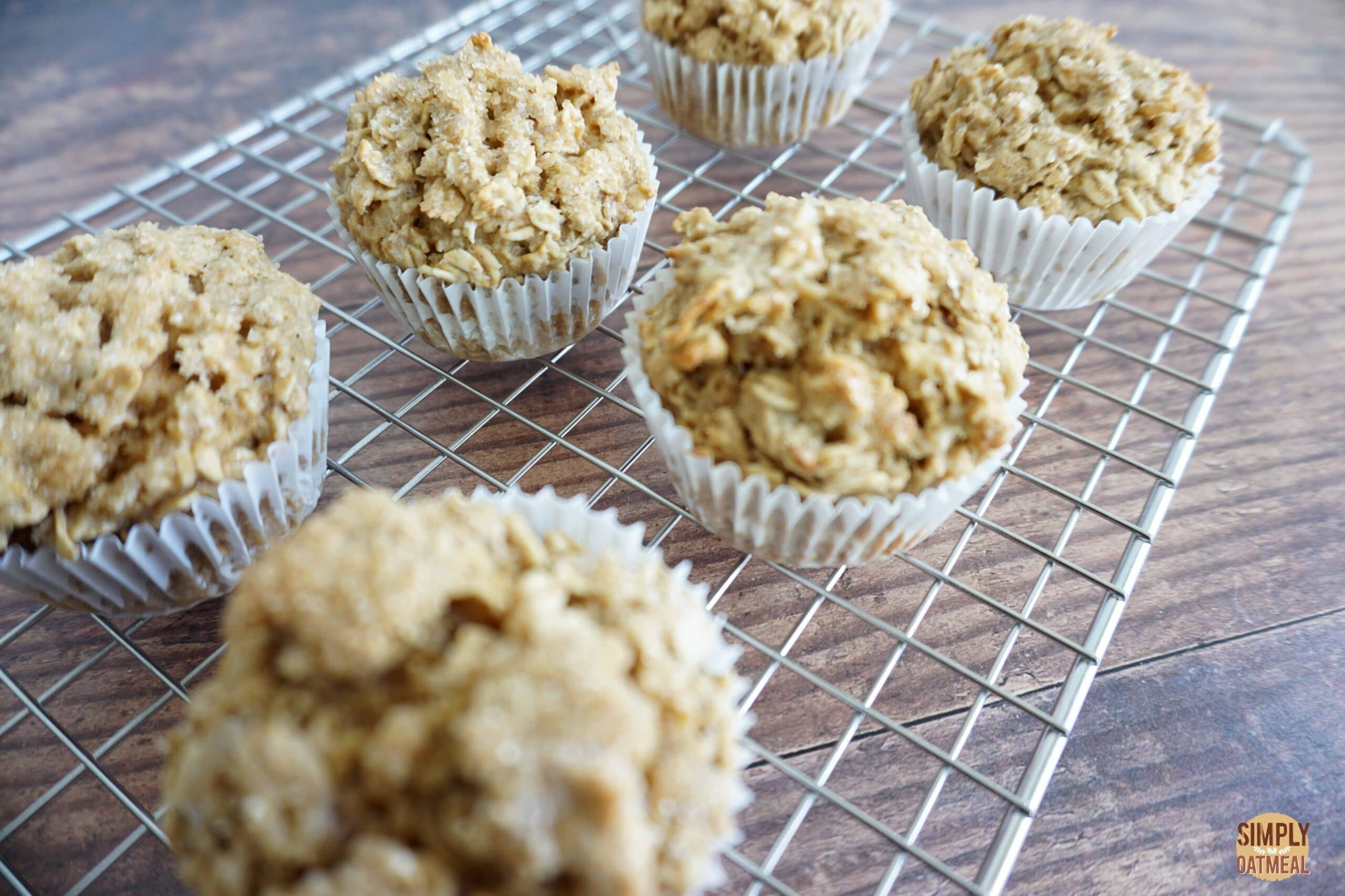 Maple brown sugar oatmeal muffins cooling on a wire rack