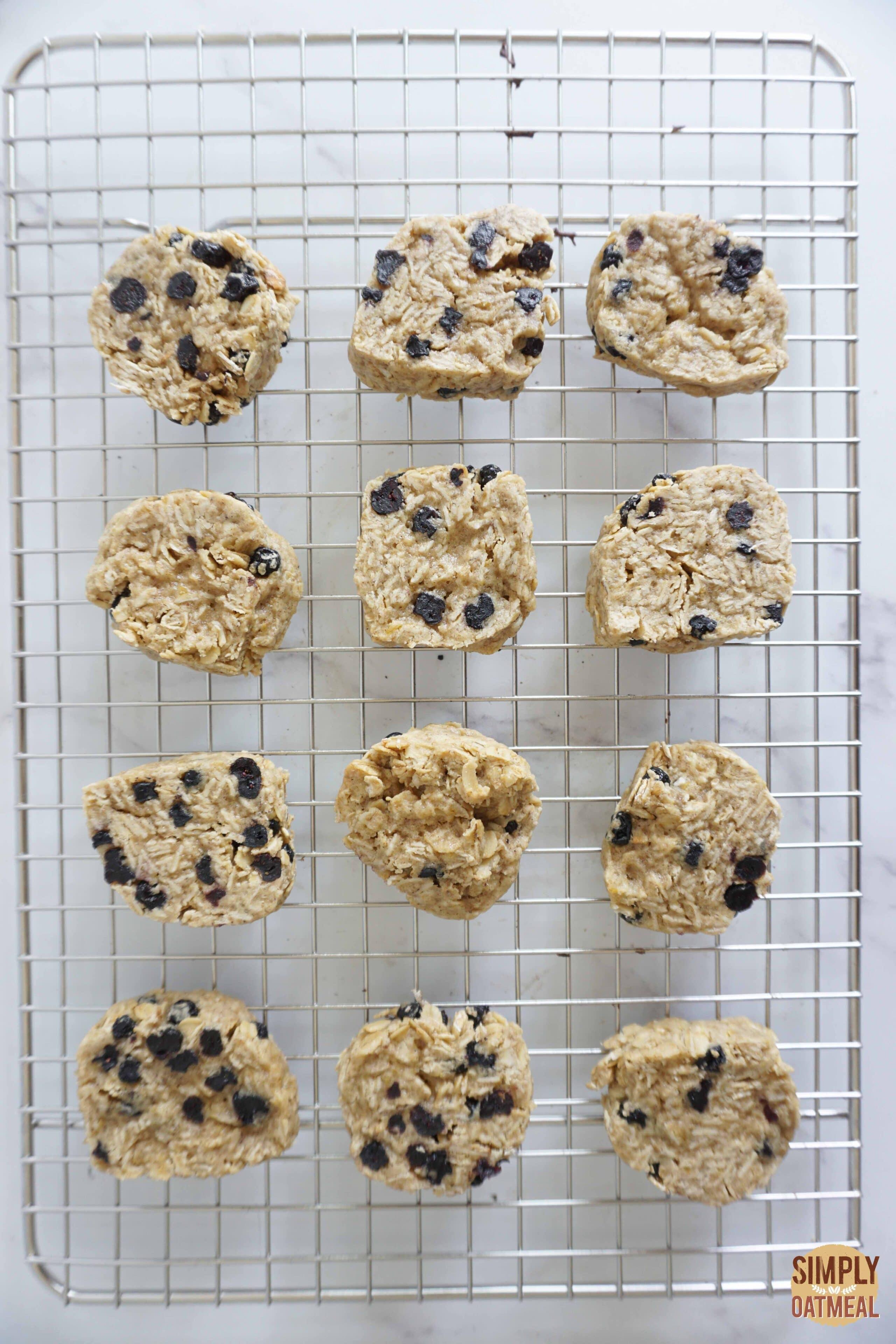 Fresh blueberry lemon oatmeal cookies on a wire rack.