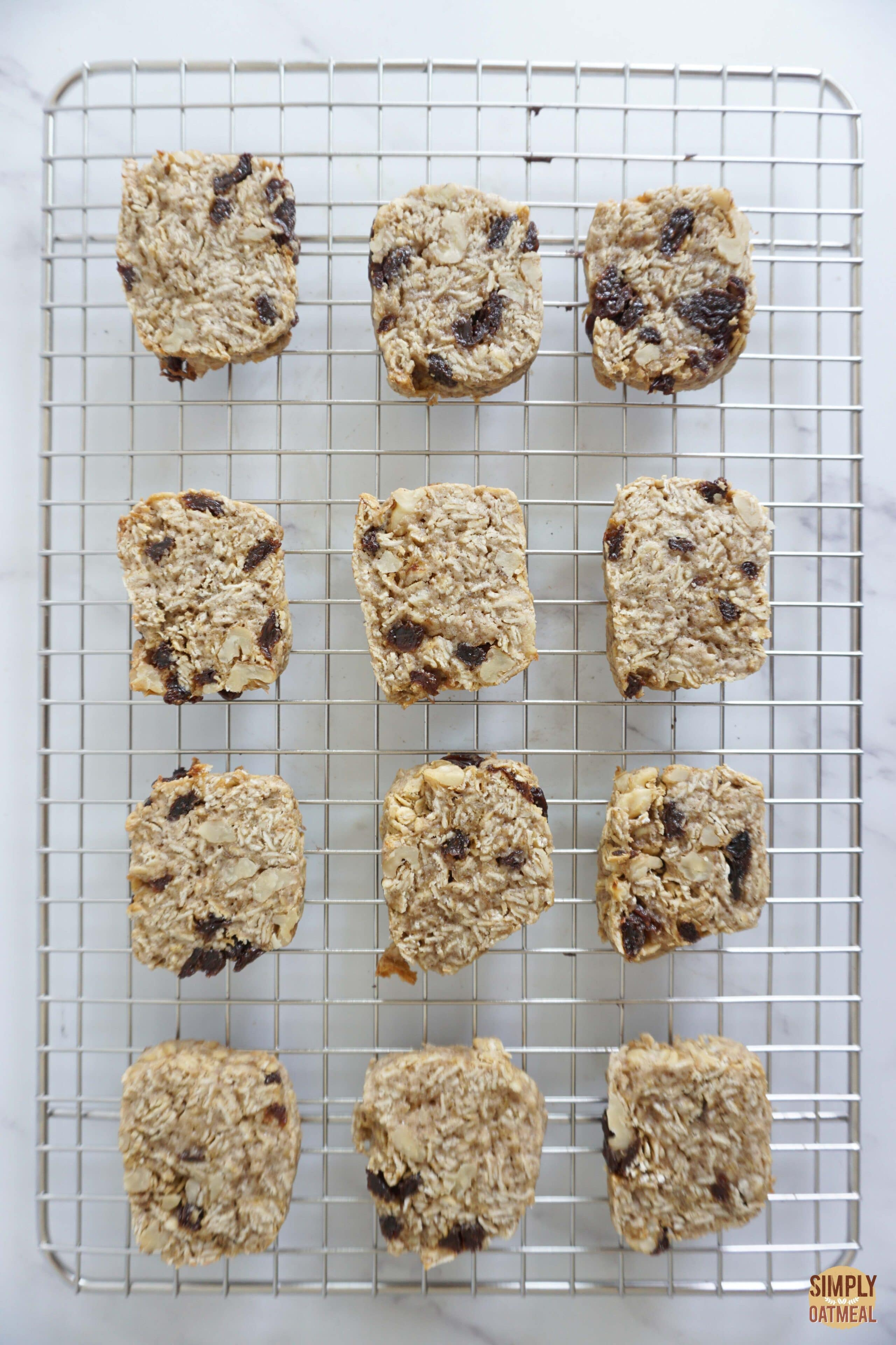 Fresh baked carrot cake oatmeal cookies on wire rack.