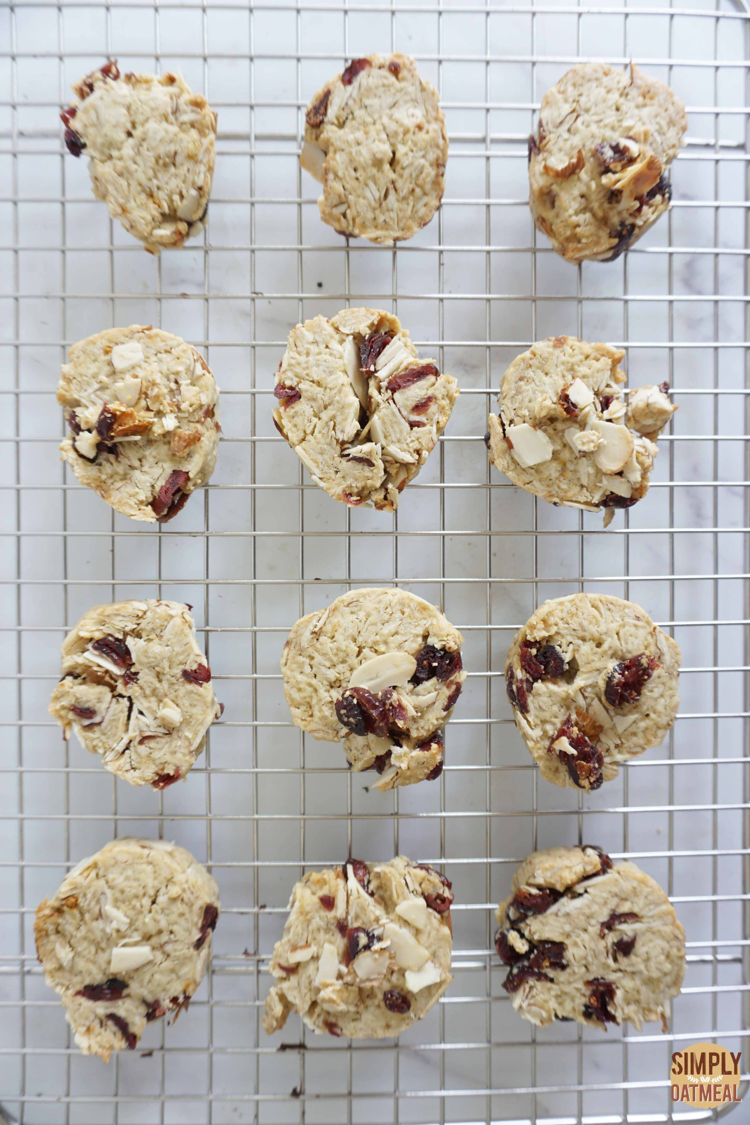 Fresh cranberry almond oatmeal cookies on wire rack.