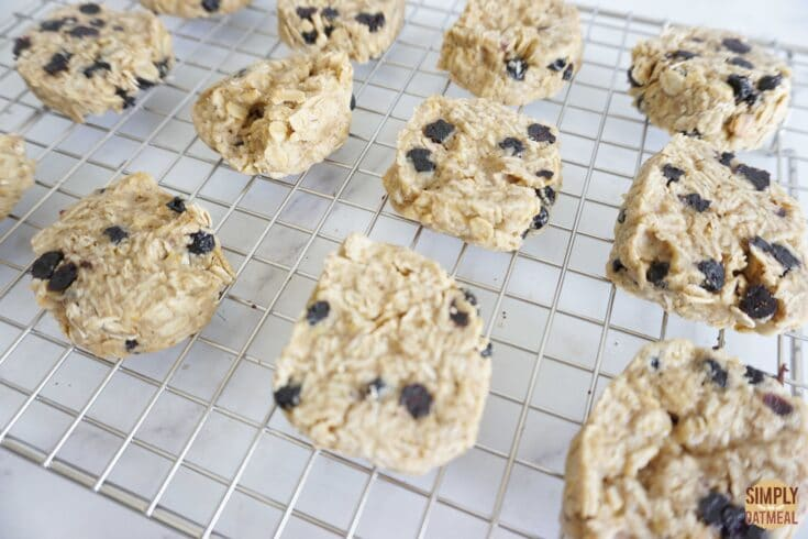 Hot blueberry lemon oatmeal cookies cooling on wire rack.