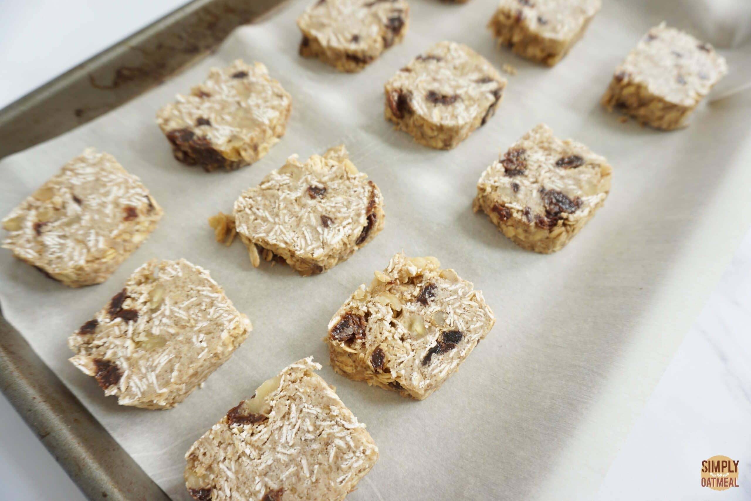 Raw carrot cake oatmeal cookies on baking sheet.
